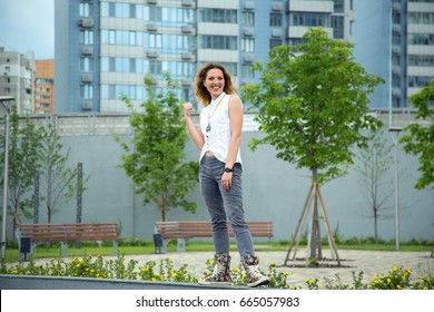 Happy modern woman on the background of city and park.