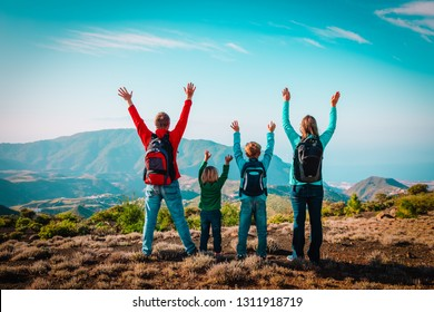 happy mom and dad with kids travel in mountains, happy family enjoy hiking