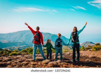happy mom and dad with kids travel in mountains, family enjoy hiking