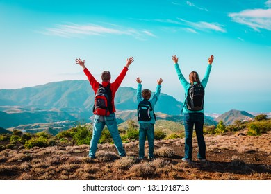 happy mom and dad with son travel in mountains, happy family enjoy hiking
