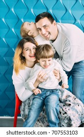 Happy mom and dad with two little boys