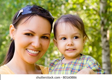 happy mom with her daughter in a park