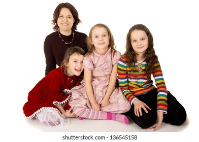 happy mom with young daughters