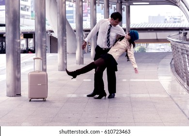 Happy moment of Asian couple holding or hugging at the train station ,vintage tone