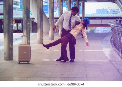Happy moment of Asian couple holding or hugging in the Airport,transportation and journey concept