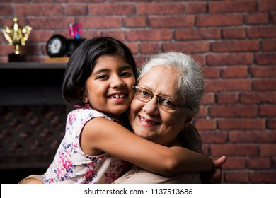 Happy moments with grandma, indian/asian senior lady spending quality time with her grand daughter