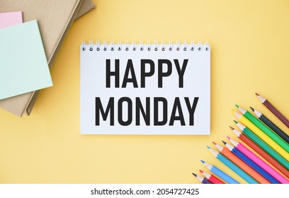 Happy monday. Blank album paper with happy monday inscription on table with office items