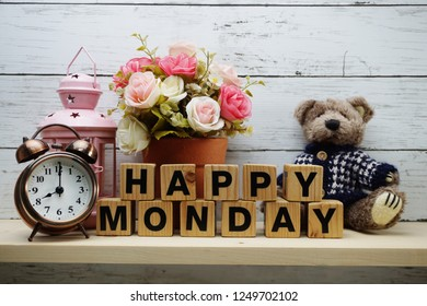 Happy Monday wooden letter alphabet with decorate item on wooden background