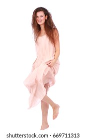 Happy morning woman in light pink dress isolated on white background