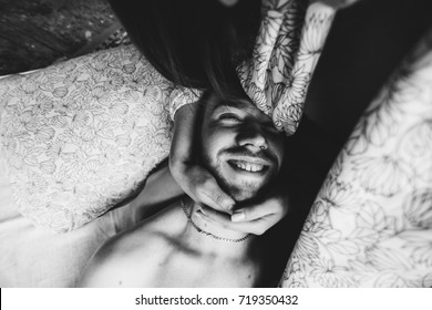 Happy morning of Young romantic couple in love have fun, kissing and hugs in bedroom . Love and relationships lifestyle, interior loft  bedroom. Black and white photo