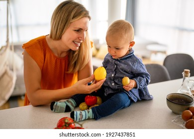 Happy mother with adorable toddler child. Family, parenting, childhood concept.