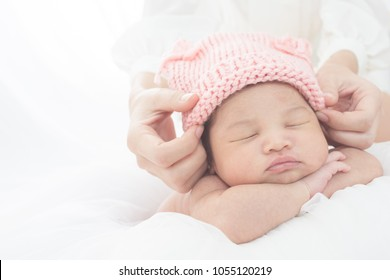 happy mother with baby in bed