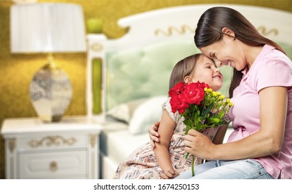 Happy mother and child giving her flowers