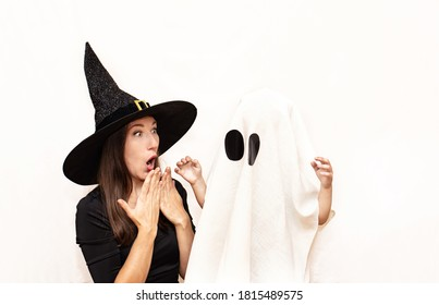 Happy mother and child in witch and Ghost costumes have fun at the party. The concept of Halloween