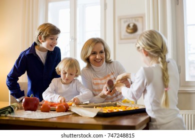 happy mother and children cooking