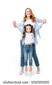 happy mother and cute little daughter holding hands isolated on white