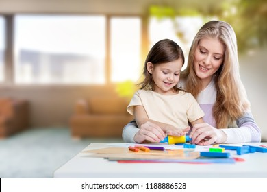 Happy Mother and daughter drawing