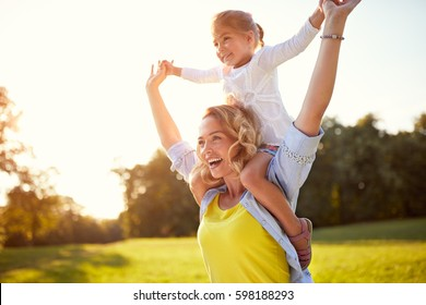 Happy mother with daughter enjoying in park