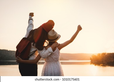 Happy mother and daughter looking at the sky during sunset, Relax time on holiday concept travel,selective and soft focus,color of hipster style