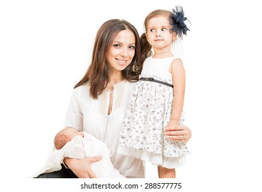 Happy mother with daughter and newborn baby  isolated