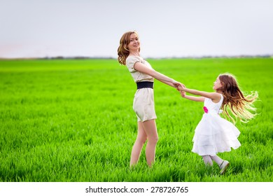 Happy mother and daughter on the   glade