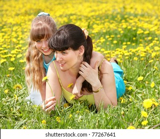 Happy mother with daughter outdoor.