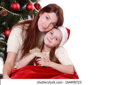happy mother and daughter over christmas tree on Holiday theme isolated on white/happy mother and daughter over christmas tree