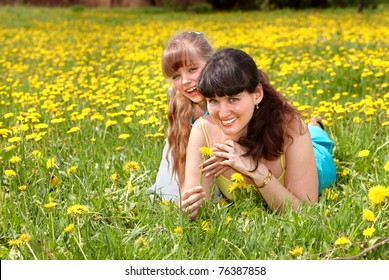 Happy mother and daughter in park outdoors.
