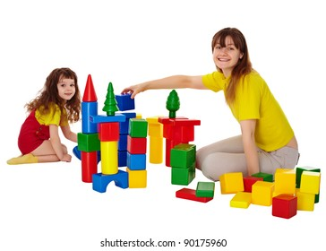 Happy mother and daughter playing with blocks isolated on white
