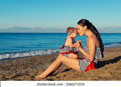 Happy mother and daughter portrait. Family holiday by the sea.