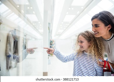 Happy mother and daughter in shopping mall together