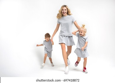 happy mother with the daughter and the son on a white background