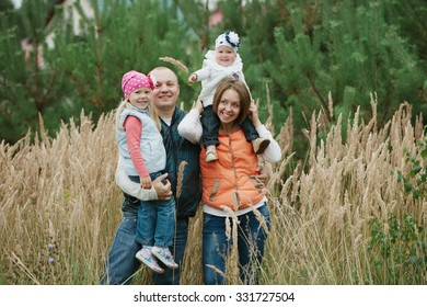 happy mother and father with two daughters portrait