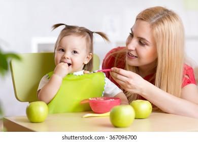 Happy Mother Feeding Baby