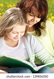 Happy mother and girl reading book �¢?? education time