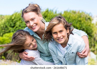 Happy mother with her children in the countryside