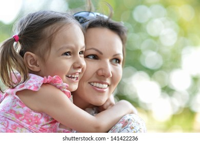 happy mother with her cute daughter on the walk
