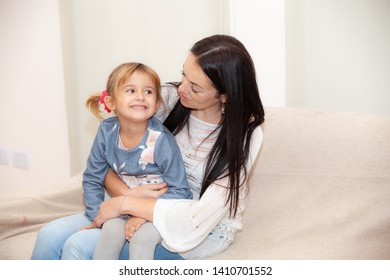 happy mother with her daughter in the room