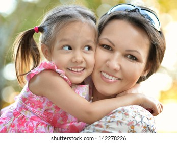 happy mother with her daughter for a walk