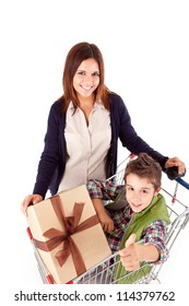 Happy mother with her kid sitting in shopping basket
