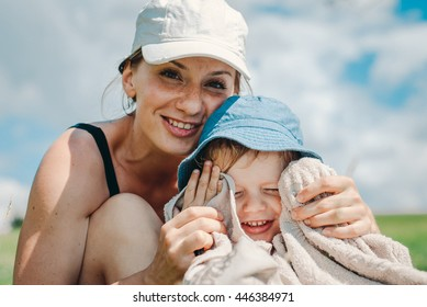 Happy mother with her little son
