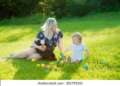 Happy Mother and Her Son Have Similar Blond Hair