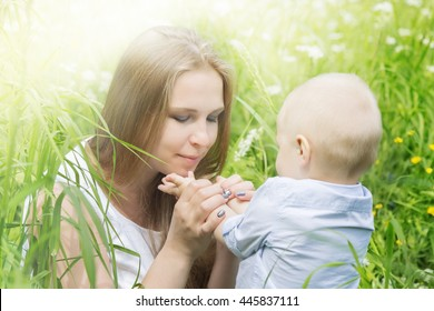 Happy mother with her son in a meadow