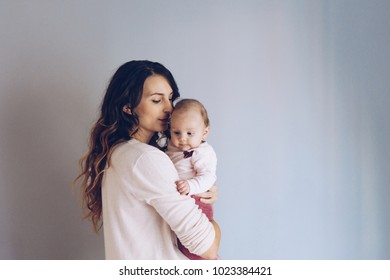 Happy mother holding adorable  baby girl