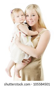 Happy mother holding smiling one year daughter over white