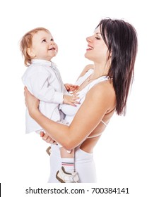 Happy Mother holding son both wearing white isolated