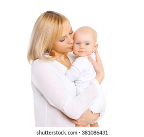 Happy mother hugging her baby on a white background