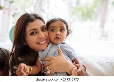 Happy mother hugging her cute little daughter
