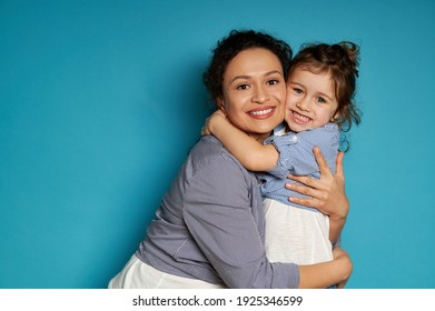 Happy mother hugging her daughter. Blue background, happy mother's day concept, Children protection day