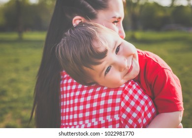 happy mother with kid having fun outdoors. hipster style. casual clothes. concept of happy family